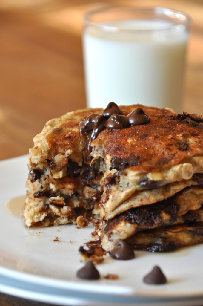 Stack of Chocolate Chip Oatmeal Pancakes and almond milk for an incredible vegan breakfast