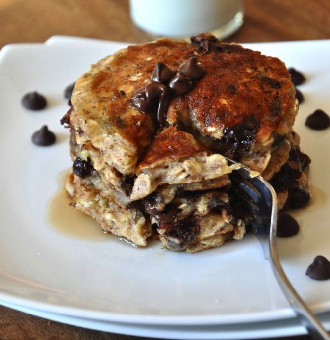 Using a fork to grab a big bite of our delicious Chocolate Chip Oatmeal Pancakes