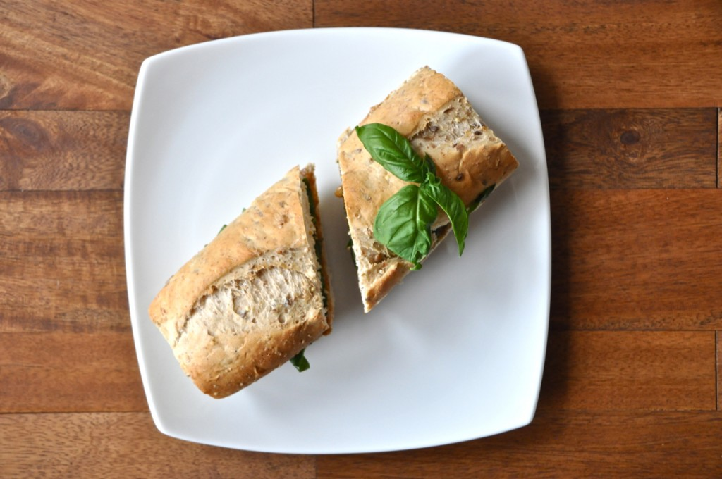 Halved Basil and Peanut Butter Sandwich on a plate