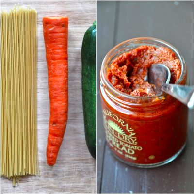 Spaghetti noodles, carrot, zucchini, and pesto for making a simple pasta dish