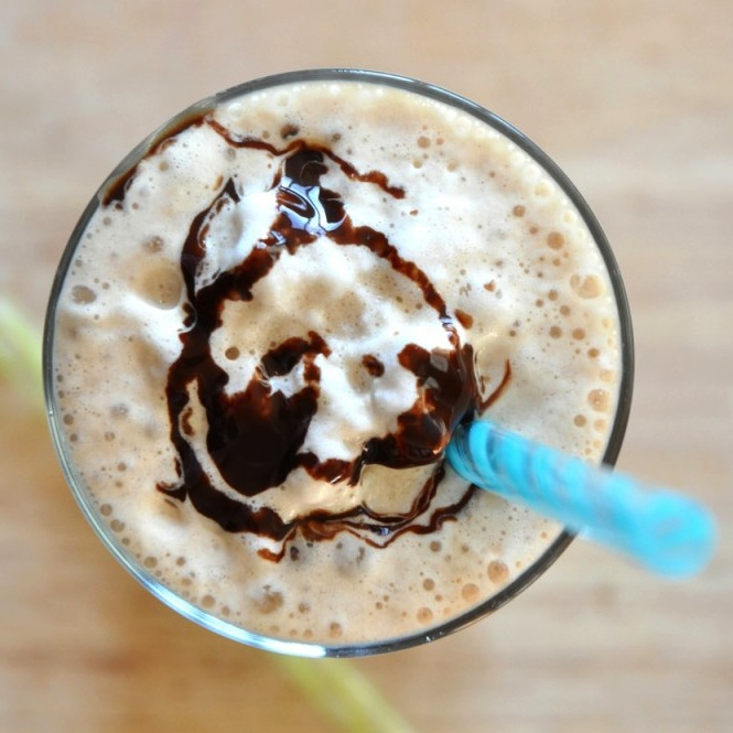 Top down shot of a Cold Brew Mocha Frappe topped with chocolate syrup