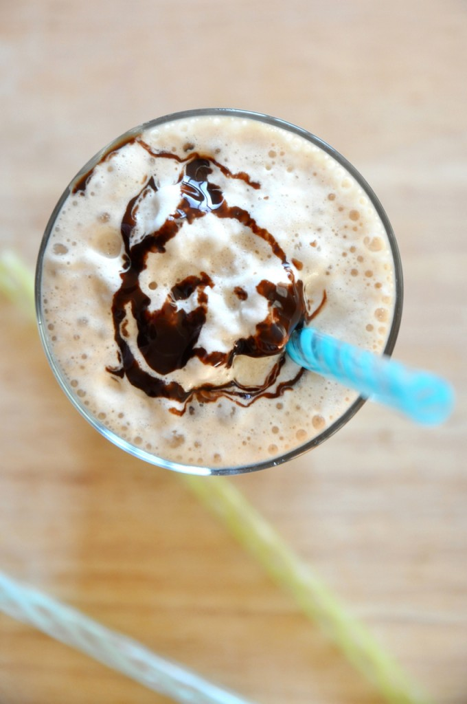 Top down shot of a Cold Brew Mocha Frappe topped with whipped cream and chocolate sauce