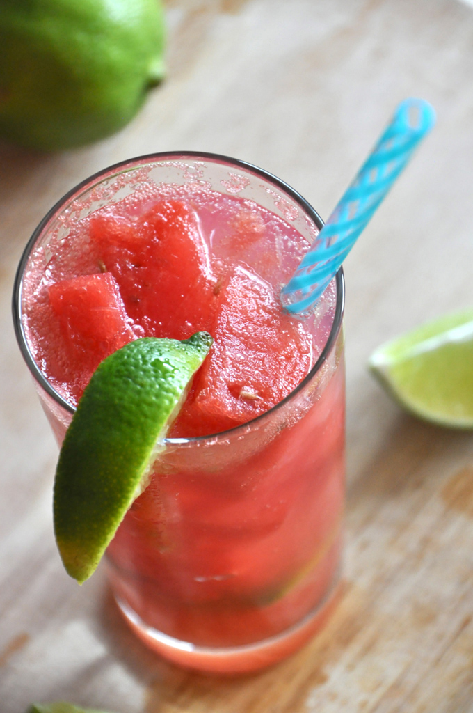 Close up shot of a Watermelon Limeade Cocktail with frozen watermelon chunks in it