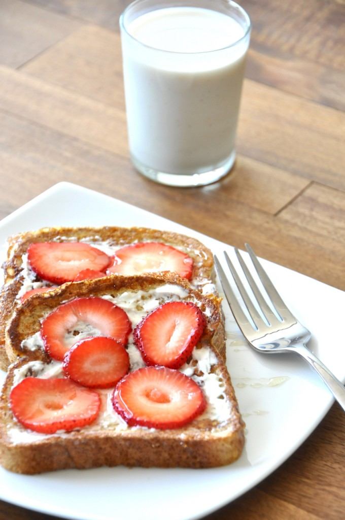 Plate with slices of Strawberry Danish French Toast alongside a glass of milk
