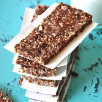 Stack of No Bake Cookie Bars with pieces of paper between them