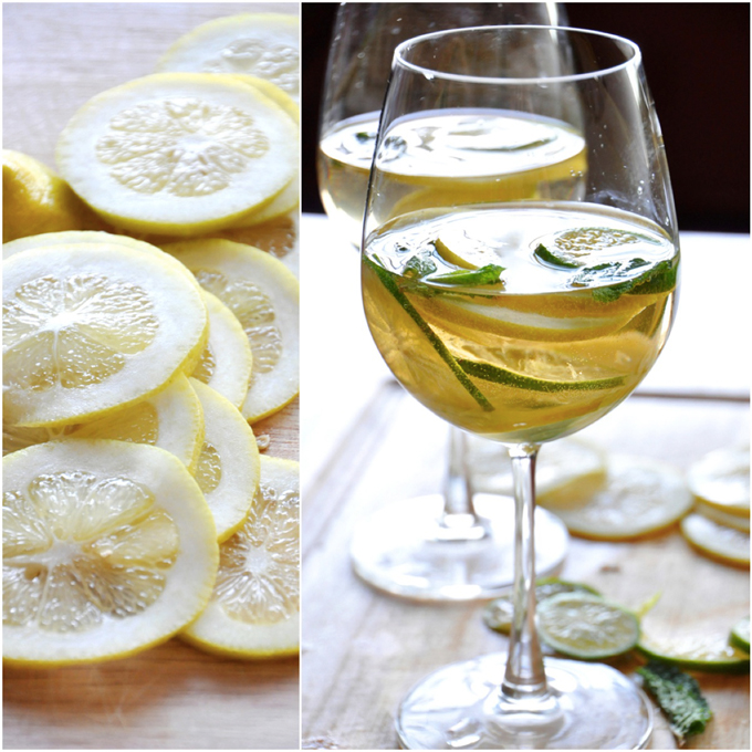 Fresh lemon slices and glasses of Mint and Citrus White Wine Sangria