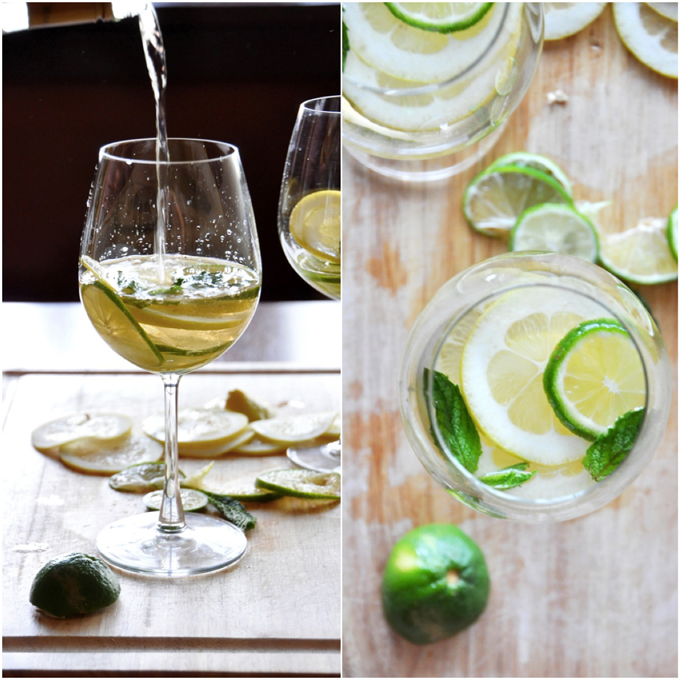 Pouring white wine into a glass for our Mint and Citrus White Wine Sangria recipe