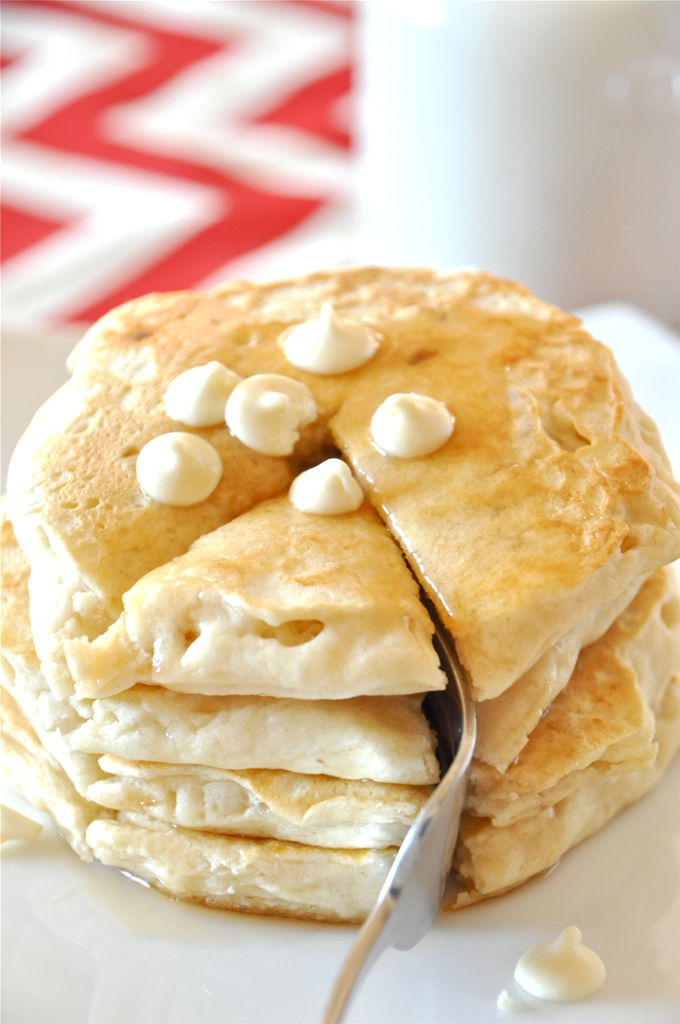 Grabbing a bite from a batch of our White Chocolate Macadamia Nut Pancakes recipe