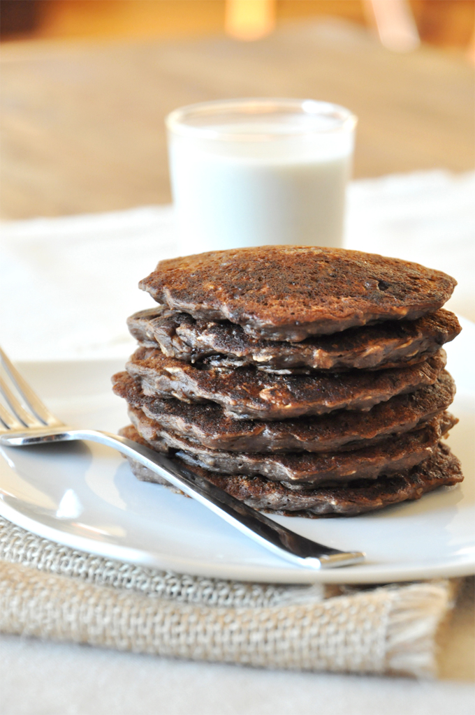 Stack of No-Bake Cookie Pancakes alongside a glass of soy milk