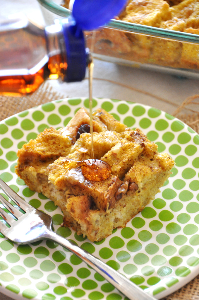 Drizzling maple syrup onto a slice of our Pumpkin French Toast Bake recipe