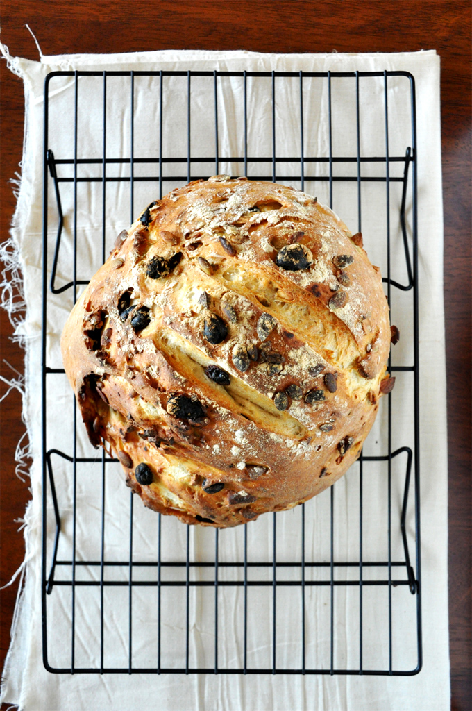 Loaf of homemade Muesli Bread on a cooling rack