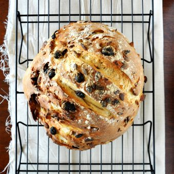 Loaf of our beautiful artisan Muesli Bread recipe cooling on a baking rack