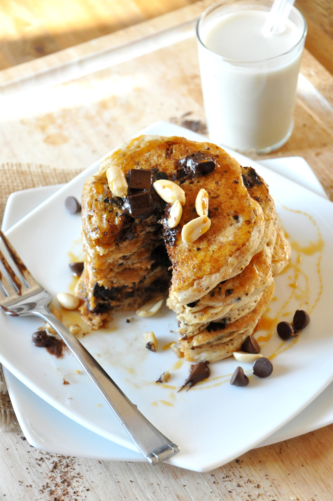Stack of Vegan Snickers Pancakes with a slice removed