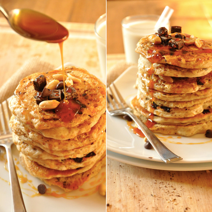 Drizzling caramel sauce onto a stack of Vegan Snickers Pancakes