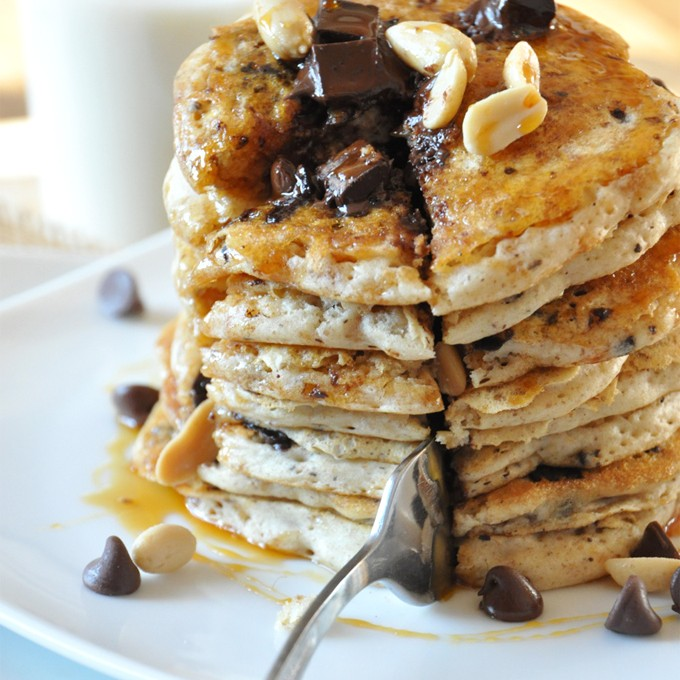 Using a fork to cut out a slice of Vegan Snickers Pancakes for a special breakfast