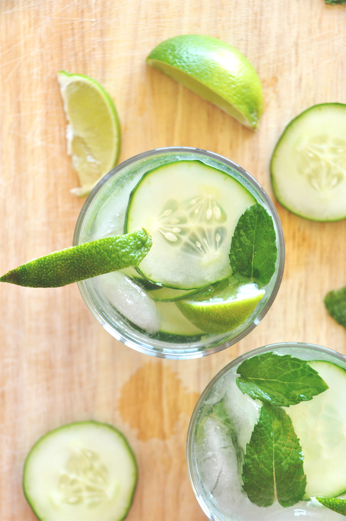 Top down shot of a refreshing Cucumber Cooler Cocktail with lime and mint
