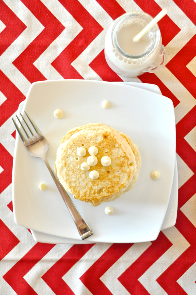 Plate of White Chocolate Macadamia Nut Pancakes and a glass of soy milk