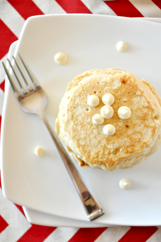 Plate with a batch of our vegan White Chocolate Macadamia Nut Pancakes recipe
