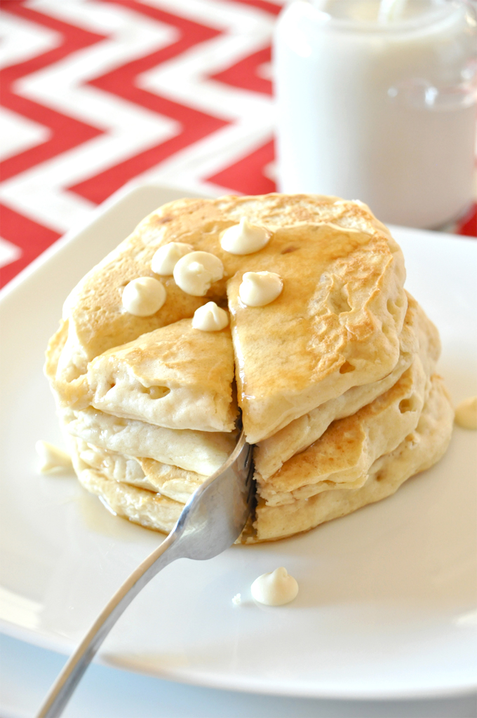 Grabbing a bite of our delicious White Chocolate Macadamia Nut Pancakes for breakfast