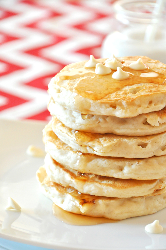 Close up shot of a fluffy stack of vegan White Chocolate Macadamia Nut Pancakes