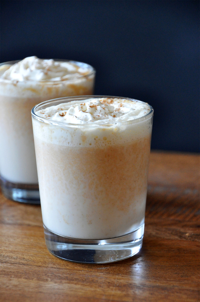 Glasses of Boozy Pumpkin White Hot Chocolate topped with whipped cream