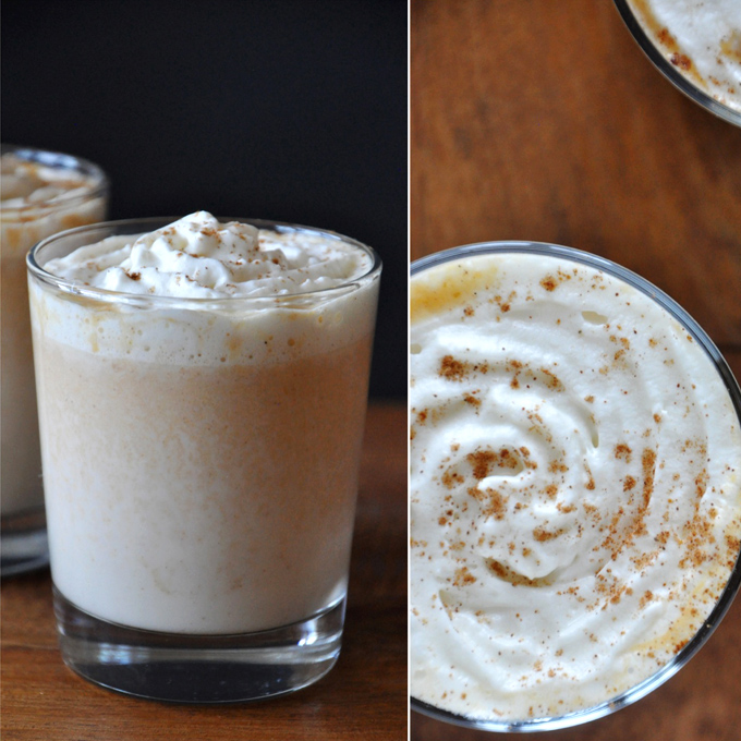 Glasses filled with our Boozy Pumpkin White Hot Chocolate recipe and whipped cream