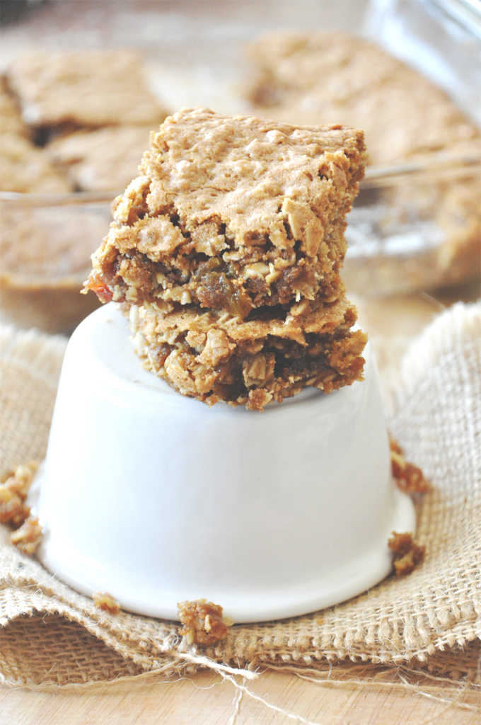 Stack of Chai-Spiced Oatmeal Raisin Bars on a stand