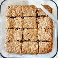 Glass baking dish of sliced Chai-Spiced Oatmeal Raisin Bars