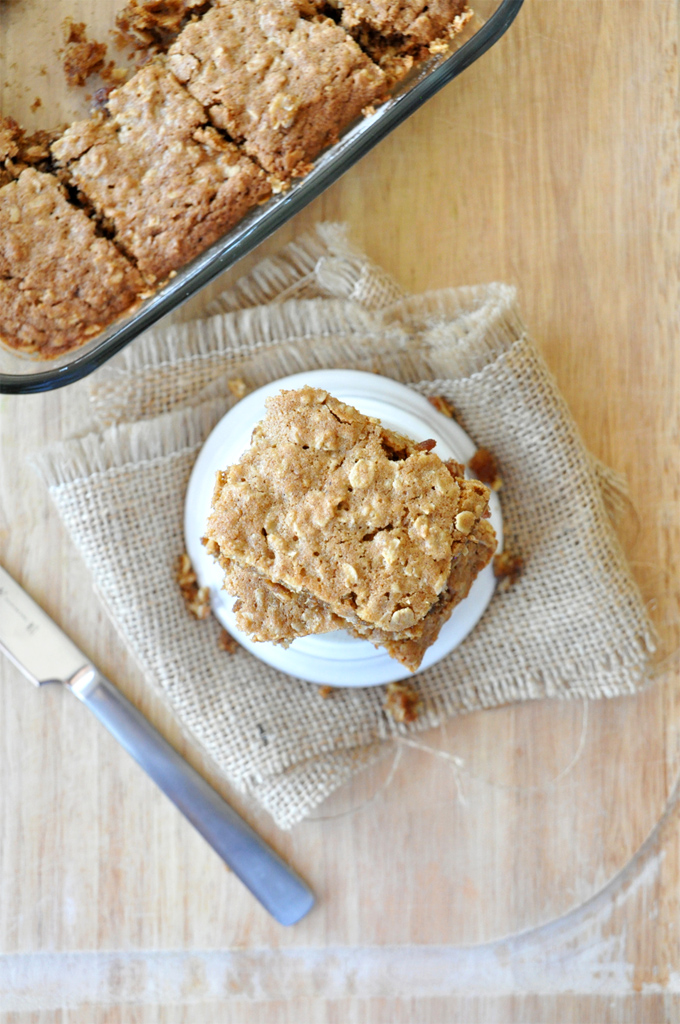 Stacked squares of our Chai-Spiced Oatmeal Raisin Bars for a hearty dessert