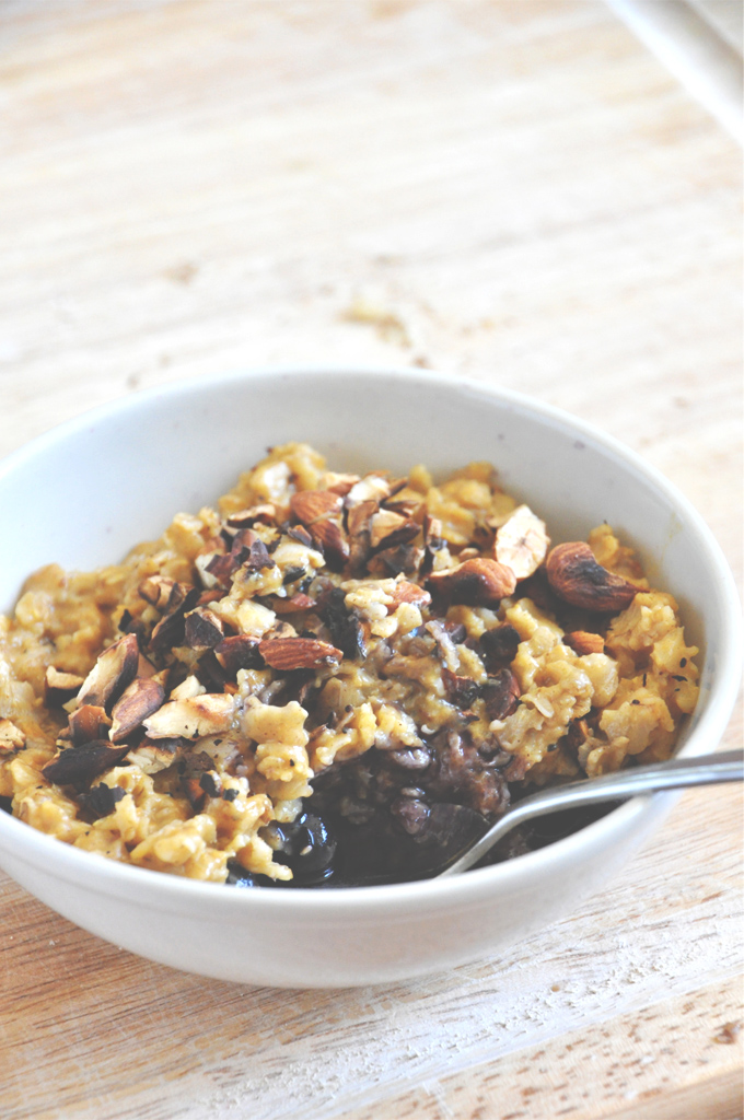 Big bowl of our Creamy Pumpkin Oats recipe with Blueberries and Toasted Almonds