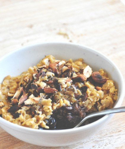 Bowl of gluten-free vegan Pumpkin Oats with Blueberries and Toasted Almonds