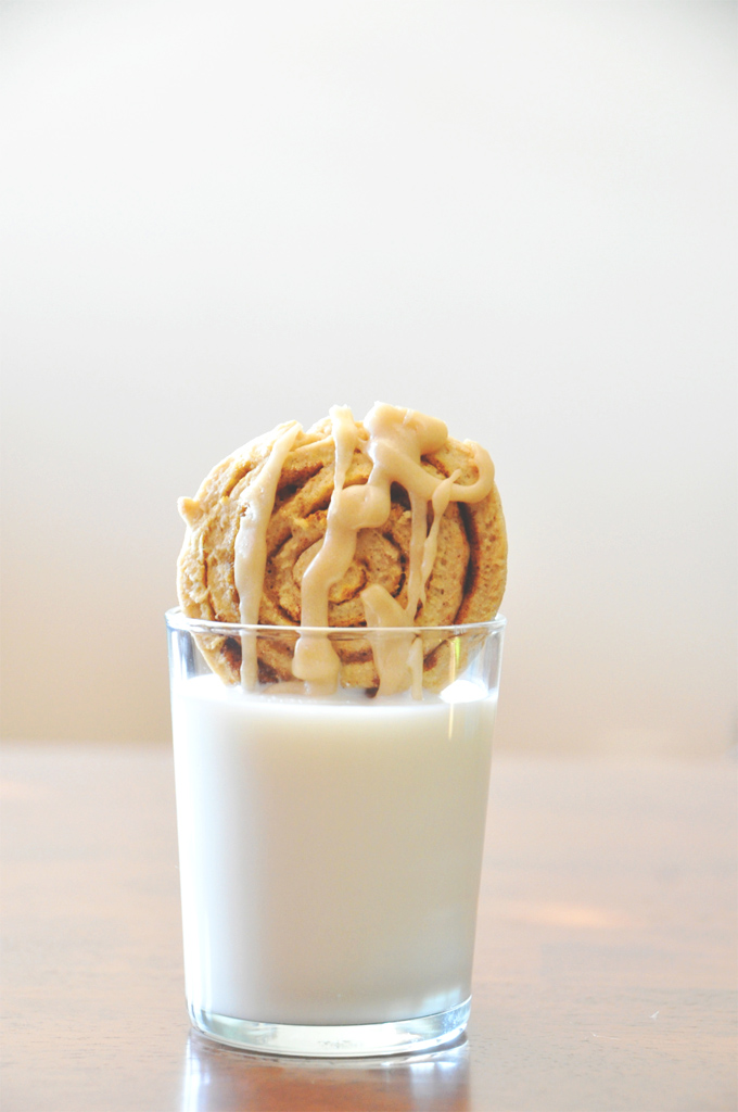 One of our delicious Pumpkin Cinnamon Roll Cookies dipped into milk