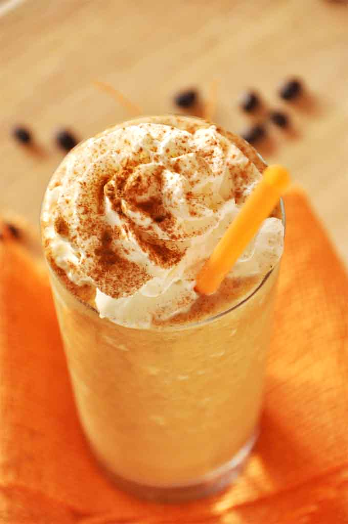 Tall glass of our homemade healthier Pumpkin Frappuccino recipe for a delicious treat