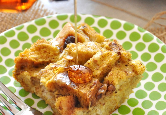 Drizzling syrup onto a square of our Pumpkin French Toast Bake recipe