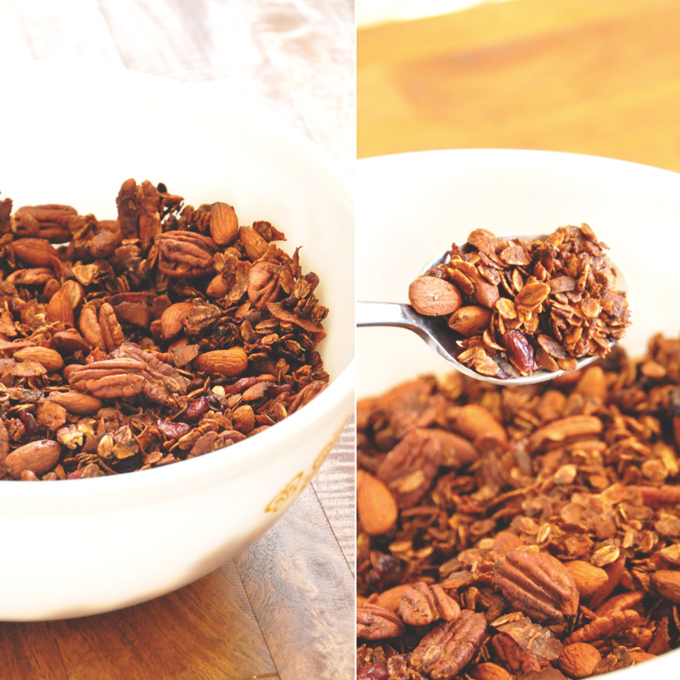 Holding up a spoonful of Nut and Honey Coconut Granola made with almonds and pecans