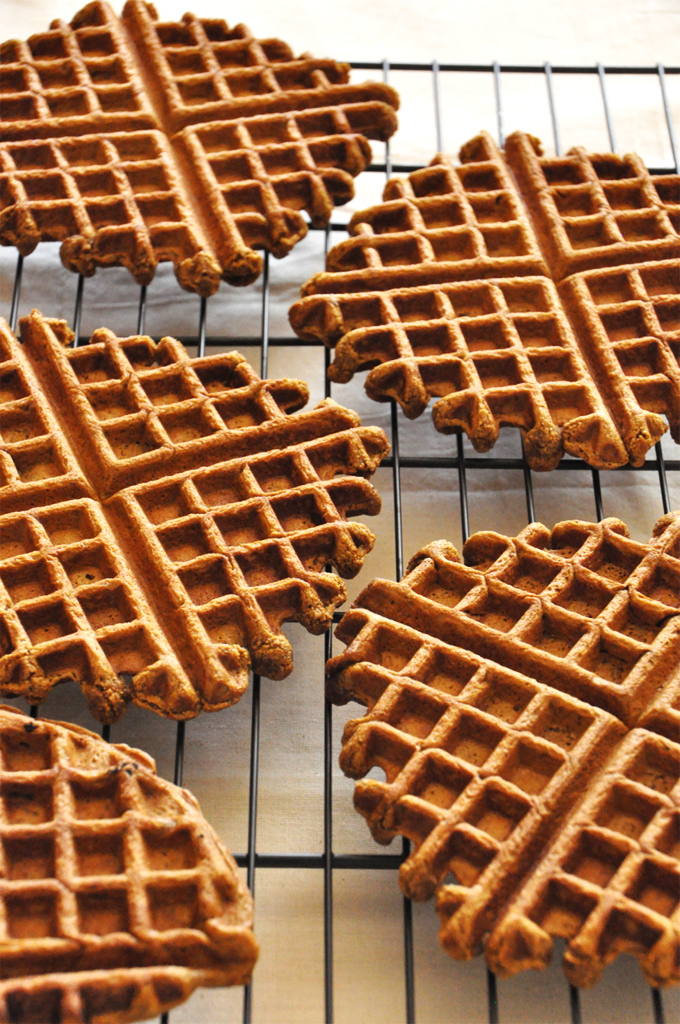 Batch of homemade Vegan Gingerbread Waffles on a cooling rack