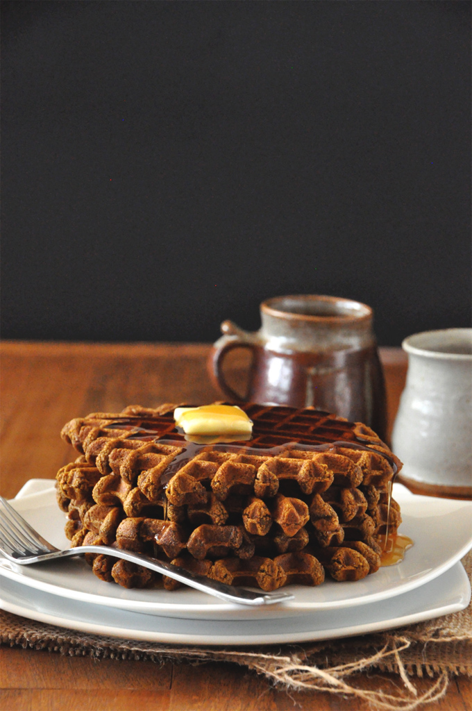 Stack of a batch of our simple Vegan Gingerbread Waffles topped with syrup and butter