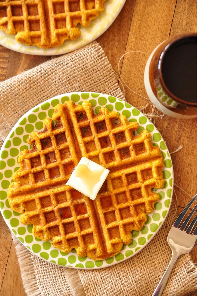 Plates of homemade Pumpkin Cornbread Waffles for a delicious vegan breakfast