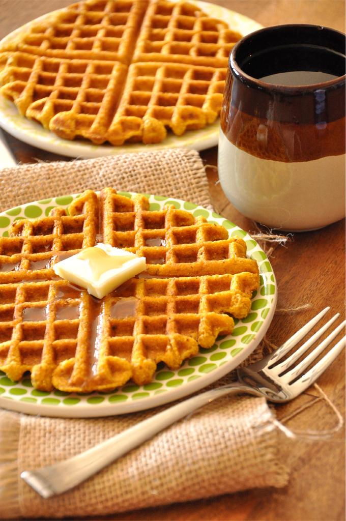 Mug of coffee and plates of Vegan Pumpkin Cornbread Waffles