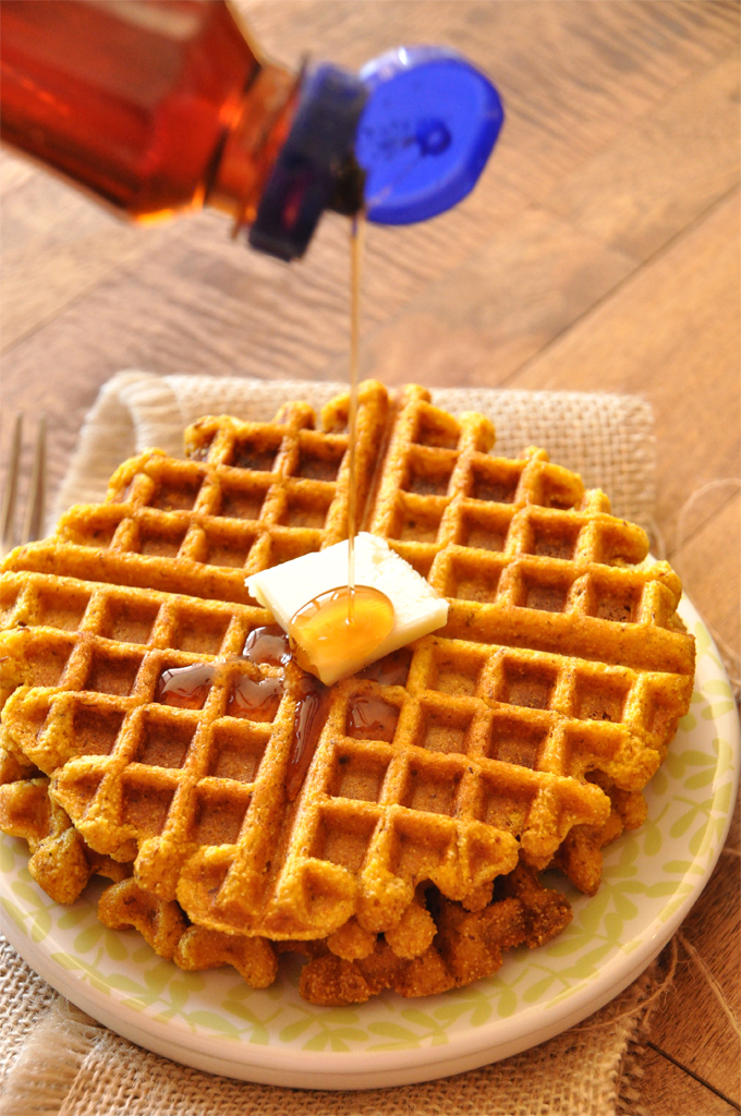 Drizzling syrup onto a batch of our Vegan Pumpkin Cornbread Waffles recipe