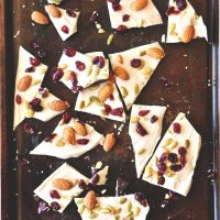 Pieces of homemade Pumpkin Bark on a baking sheet