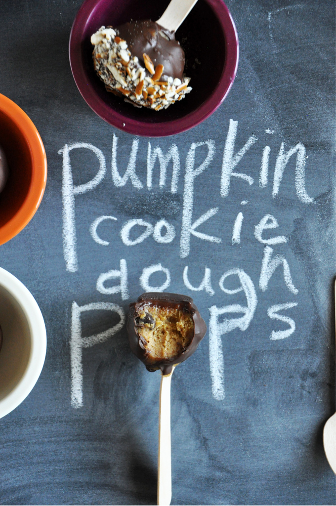 Pumpkin Cookie Dough Pops on a chalkboard and in bowls