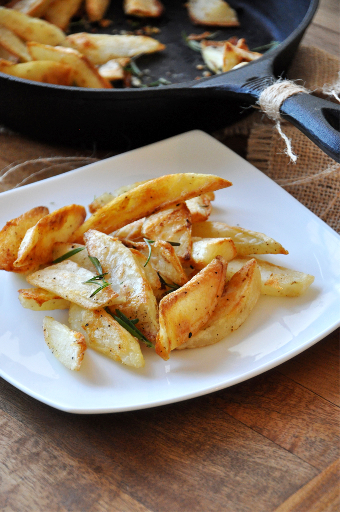Plate of gluten-free healthier french fries with fresh rosemary