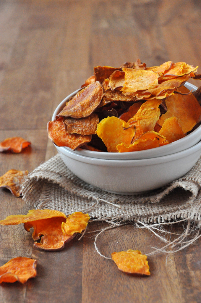 Bowl piled high with a batch of our Baked Sweet Potato Chips recipe