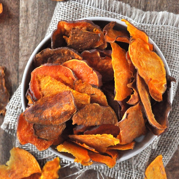 Top down shot of an overflowing bowl of Baked Sweet Potato Chips