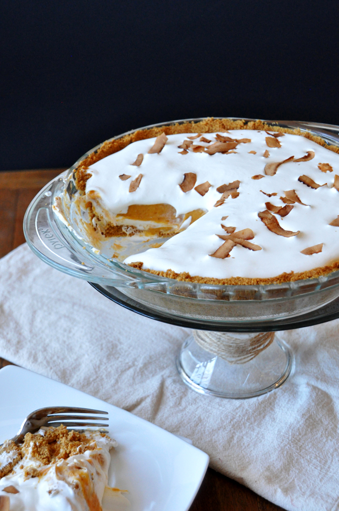 Creamy Pumpkin Pie perched on a cake stand for a delicious Thanksgiving dessert recipe