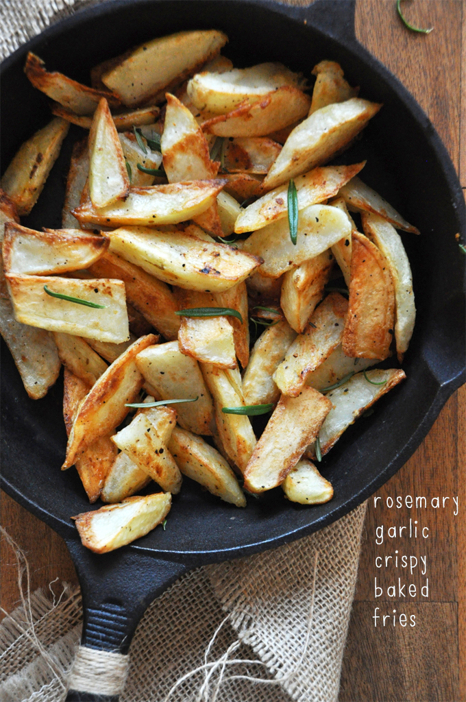 Cast-iron skillet filled with a batch of our homemade Crispy Baked Rosemary Garlic Fries