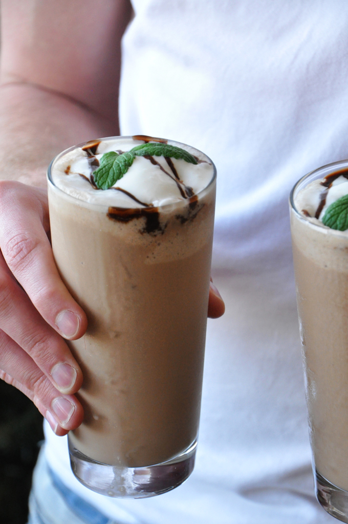 Holding two glasses of our Peppermint Mocha Frappe for a refreshing summer beverage