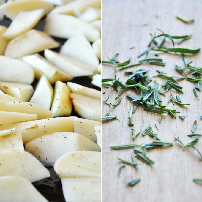 Chopped potatoes and rosemary for making Crispy Baked Rosemary Garlic Fries
