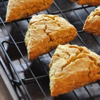 Batch of homemade Pumpkin Scones on a cooling rack